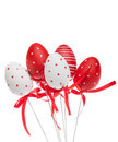 Red and white decorative easter eggs with ribbons isolated Royalty Free Stock Photo