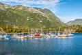 Red and white fishing boats stand moored in Norway village Royalty Free Stock Photo