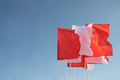Red and white flags flutter in wind Royalty Free Stock Image