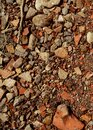 Red and white granite fine gravel. Simple stone background with red pebbles. Stone texture. Top view of ground decor Royalty Free Stock Photo