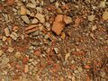 Red and white granite fine gravel. Simple stone background with red pebbles. Stone texture. Top view with colorful Royalty Free Stock Photo