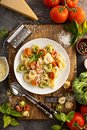 Red, white and green tortellini with vegetables and cheese Royalty Free Stock Photo