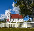 White Picket Fence Around the Church Royalty Free Stock Photo