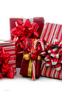 Red and white holiday gifts and candy cane are wrapped in paper bows highlighted with striped canes Stock Photos