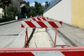 Red and white hurdles in the construction site during roadworks Stock Photography