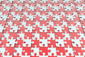 Red and white jigsaw puzzle background Royalty Free Stock Photo
