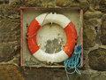 Red and White Life Ring on Quay Royalty Free Stock Photo