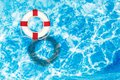Red and white Lifebuoy on blue water surface Royalty Free Stock Photo