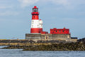 Red and white lighthouse longstone Stock Photography