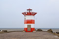 Red and white lighthouse on north sea in the hague holland Royalty Free Stock Photo