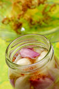 Red and white onions in jar Stock Image