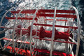 Red and White Paddle Wheel on Lake Royalty Free Stock Photo