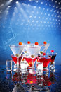 Red and white party cocktails on blue Stock Images