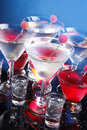 Red and white party cocktails on blue Stock Photography