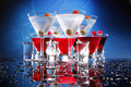 Red and white party cocktails on blue Stock Image