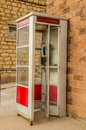 Red and White Phone Booth Royalty Free Stock Photo
