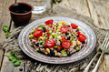 Red and white rice black beans corn avocado tomato salad Royalty Free Stock Photo