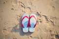 Red and white sandal on the beach Royalty Free Stock Photo