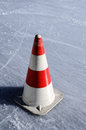 Red white striped cones on the ice rink vertical Stock Photo