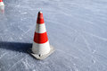 Red white striped cones on the rink ice horizontal Royalty Free Stock Photos