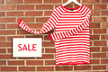 Red and white striped shirt with sale sign inviting to Royalty Free Stock Image