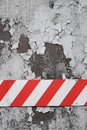 Red and white striped warning sign on aged wall Royalty Free Stock Photo