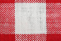 Red and white tablecloth macro Royalty Free Stock Images