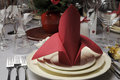 Red and white theme wedding breakfast dining table setting close up. Royalty Free Stock Photo
