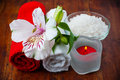 Red and white towels, aromatic salt and flower Royalty Free Stock Images