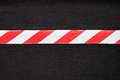 Red and white warning tape Royalty Free Stock Photo