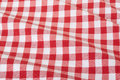 Red and white wavy tablecloth gingham texture background high detailed Royalty Free Stock Image