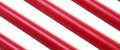 Red white wax candle stick diagonal striped background texture festive christmas conceptual close up Royalty Free Stock Photos
