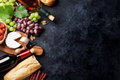 Red and white wine, grape, cheese and sausages Royalty Free Stock Photo