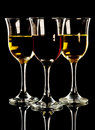 Red and white wine in three glasses Royalty Free Stock Photography