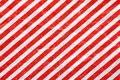 Red and white wrapping paper a crumpled sheet of christmas in a stripe pattern to use as a background Stock Images