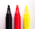 Red white and yellow markers three coloured permanent of colors black against a background Royalty Free Stock Image