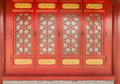 A red window of carve patterns or designs on woodwork traditional chinese architecture bright and gold shows solemn and dignified Royalty Free Stock Image