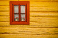 Red window, yellow wall in old house