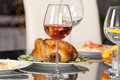 Red wine beautiful diner with and chicken in restaurant Stock Photo