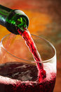 Red wine being poured into glass Royalty Free Stock Photo