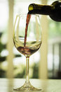Red wine being poured into glass Royalty Free Stock Image