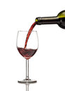 Red wine being poured into wine glass Royalty Free Stock Photo