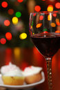 Red wine with blurred christmas lights Royalty Free Stock Images