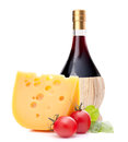 Red wine bottle cheese and tomato still life isolated on white background cutout italian food concept Royalty Free Stock Photo