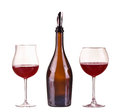 Red wine in a bottle with dispenser and two glasses with red wine glass wine bottle isolated on white Stock Images