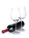 Red wine bottle and empty glasses Royalty Free Stock Image