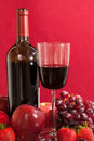 Red wine bottle and fruit with glass Stock Images
