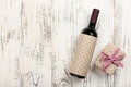 Red wine bottle and gift box Royalty Free Stock Photo