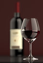 Red Wine bottle with Glass Stock Photo