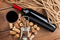 Red wine bottle, glass, corks and corkscrew. View from above Royalty Free Stock Photo